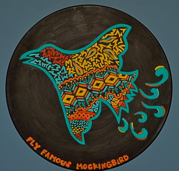 Colonel Forbin's mockingbird painted on a vinyl record