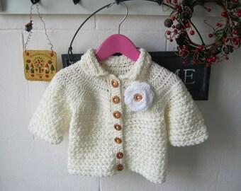 Crochet cream colour girls cardigan with flower motif