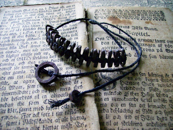 Rustic industrial bracelet with rusty metal parts on black braided cord