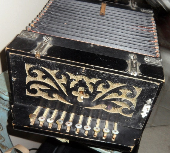 Antique musical instrument: Concertina, made in Germany by Schutz-marke.