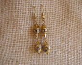 Gold and topaz dangle earrings. 2 inch hanging length.