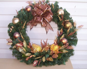 Christmas wreath with gold beaded fruit and ornaments