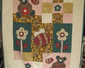 Absolutely adorable crib quilt made with appliques is soft, snuggly, and warm.