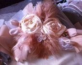 beautiful handmade bridal wrist corsage, featuring feathers, crystals, pearls , lace and ribbon.
