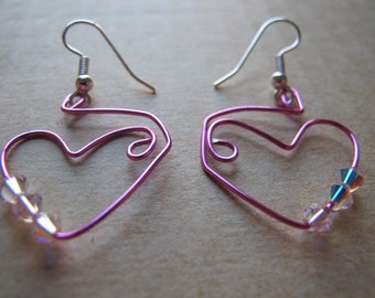Heart earrings wire wrapped pink with Swarovski crystals