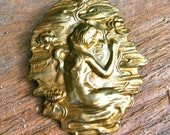 Art nouveau brooch of lady  or mermaid among flowers and lillies