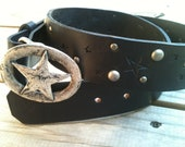 Black leather belt with embossed stars , antiqued studs, and vintage Italian made star buckle
