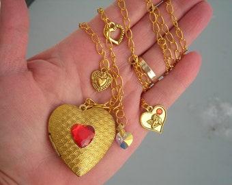 Large textured brass HEART shape LOCKET, lavaliere style w. swarovski Crystal heart & gold t. heart charms.