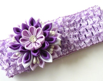 Crochet headband with Kanzashi fabric flower. Purple, orchid and white.