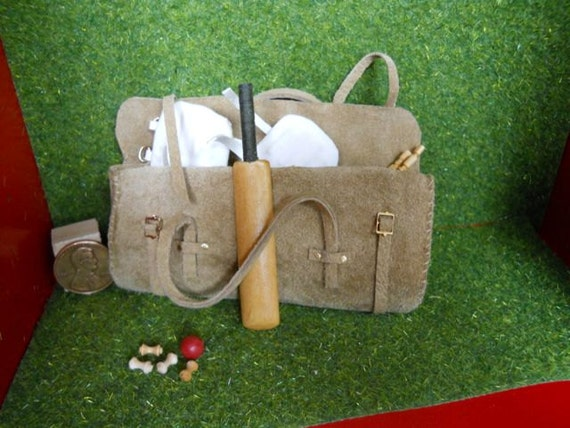 Cricketer's equipment in a carryall  Catalogue PM 61