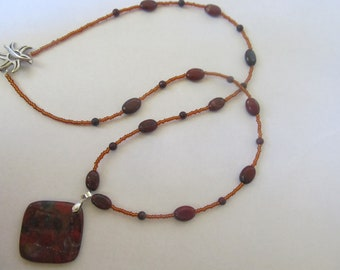 """25"""" beaded necklace with natural stone pendant"""