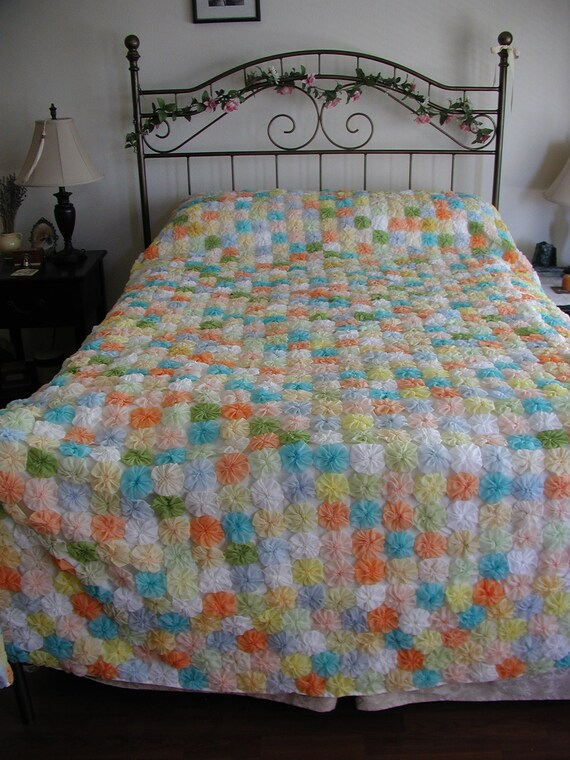 Vintage handmade yoyo rosette bedspread