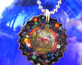 Bottle cap necklace with seed beads surrounding New Belgium bicycle picture