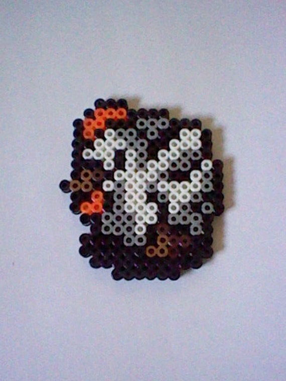 The Legend of Zelda cucco perler bead creation....melted beads with magnet on back