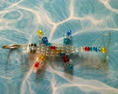 """Crafter's Favorite -Small Translucent """"Lucky Lizard"""" with a Clear Body plus Red, Yellow, Turquoise, and Blue Dots -In Honor of Autism Speaks"""