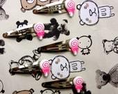 Hair clips, swirly lollipop.