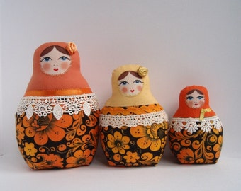 A Set of Orange Khokhloma Matryoshkas (cloth Russian babushka dolls)