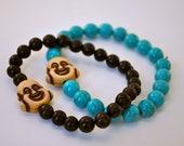 Buddha Bracelet with turquoise or black beads.