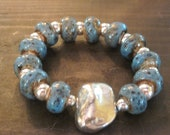 Marbeled Beauty-Blue marbeled ceramic beads and silvermetal beads with metal nugget. 2012003