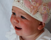 Molly Beanie- a cream hand crocheted beanie with pale pink iridescent sequin flowers