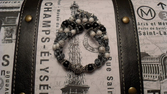 Triple stranded snowflake obsidian and black onyx bracelet
