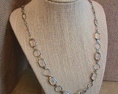"Clear and Silver (color)  necklace with 24"" chain"