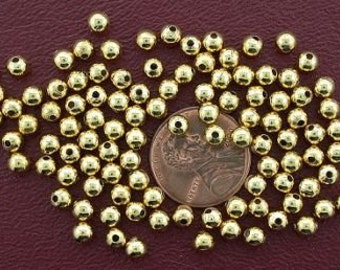 one hundred 4mm gold plated round beads