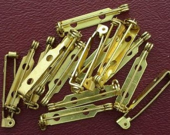 fifteen 1 inch two hole green gold pin bars