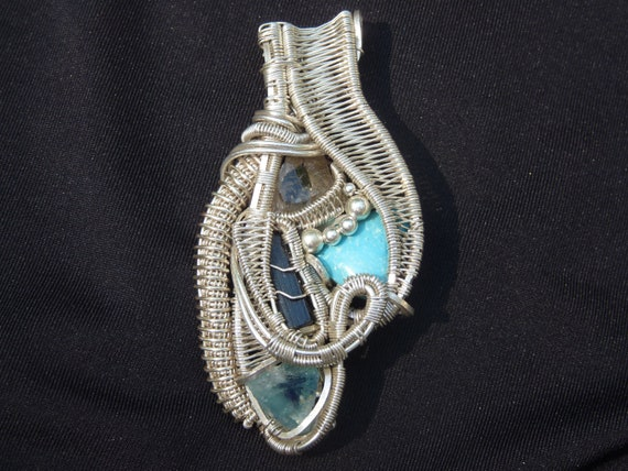 Montana quartz, Green Tourmaline, Kingman Turquoise, and Green Fluorite wire wrapped pendant.