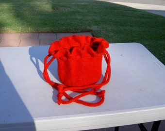 Bright red felted drawstring bag with ruffled top