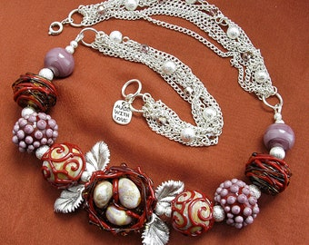 """Lampwork glass necklace """"Nest"""" with silver color metal leaves. Lilac and brown color."""