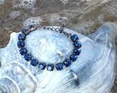 Swarovski Montana Blue 8mm 15 crystal bracelet, adjustable w/extension and lobster clasp