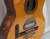 Acoustic guitar with an AM/FM stereo radio and fully functioning alarm and snooze.