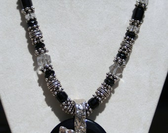 Sterling Silver, Bali beads, black onyx beads, and a Silver Papillon on black Onyx Donut