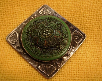 Brooch, vintage green button in handcrafted mounting