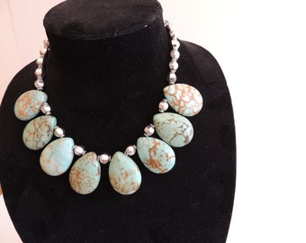 Charming necklace for any occasion. Top drilled puffed teardrop beads w/silver links. Comes with silver earings
