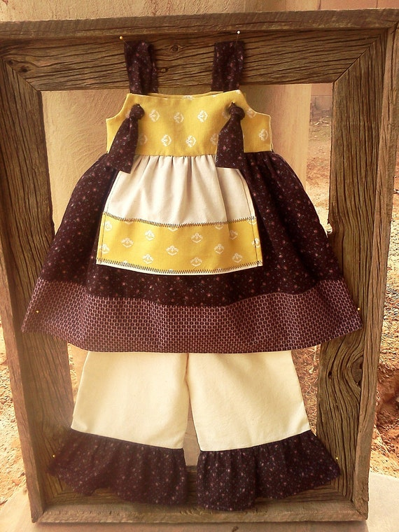 The ASHA  knot dress w/ apron & matching ruffle pants. Size 2T.