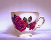 Grunge pink rose vintage tea cup photographic print
