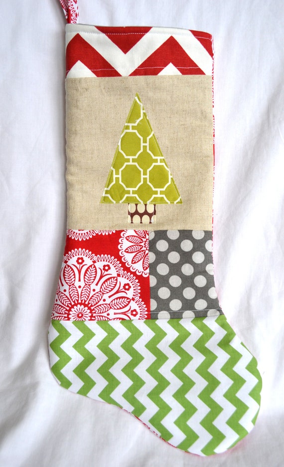 Modern christmas stocking tree on linen with red green chevron and
