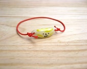 Bracelet with red elastic trim. Fruits. Porcelain charms. Pineapple, Strawberry and Banana.