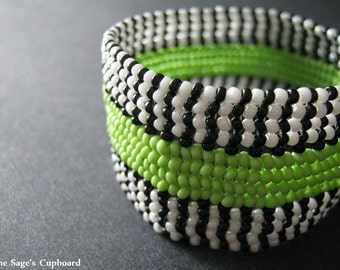 Lime Stripe Cuff. Handmade Beaded Bracelet in Green, Black, and White