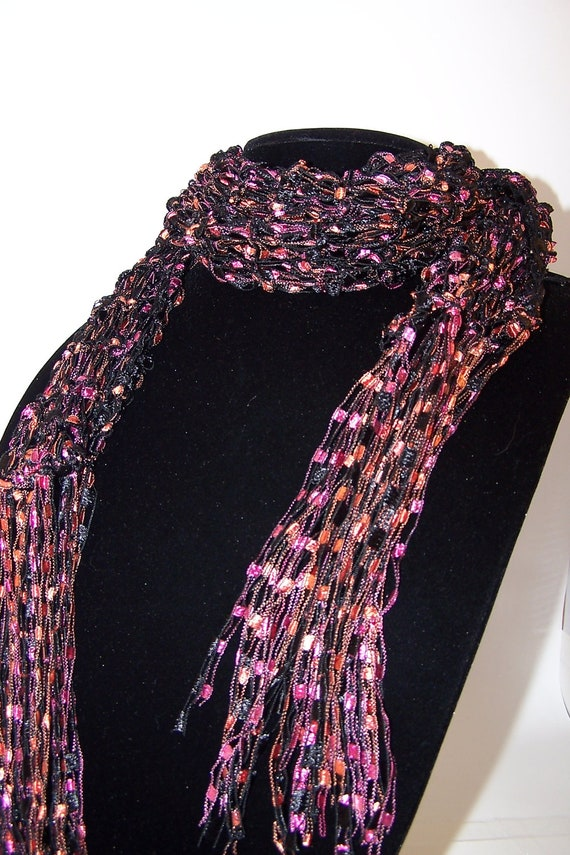 Knitting Pattern Ribbon Yarn Scarf : Knit Ladder Yarn Scarf in Black Orange Pink is by WeeCatCreations