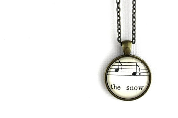 winter jewelry for woman made with vintage sheet music under glass. Gift for mother, sister, wife, girlfriend, friend