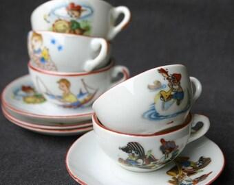 Little girl antique tea set. Miniature collectible fairytale porcelain.