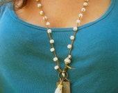 bone & buddha amulet tassel garland