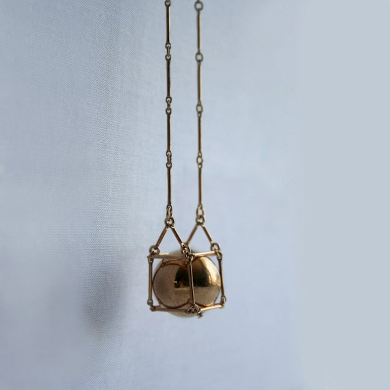 Gold cube necklace with caged ball pendant- Geometric statement necklace with bar chain - Modern fashion jewelry