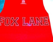 "Sugar lips tank top with a ""Fox Lane"" or any high school across front."