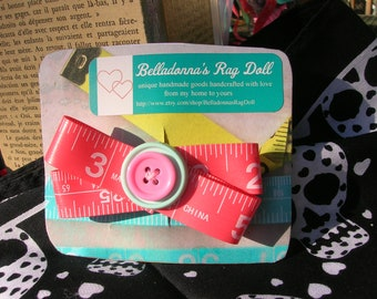 bright salmon pink, genuine measuring tape recycled handmade button hair bow, barrette, retro, quirky