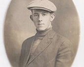 Old Photo Portrait Man wearing Cap turtleneck with Suit Jacket  Early 1900s Photograph Snapshot vintage