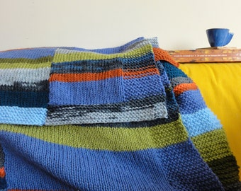 Hand knit blanket, stripes in columns in blues and greys